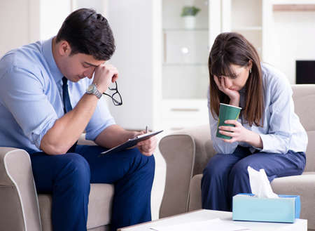 Young woman visiting male psychologist for unreciprocated love Stock Photo