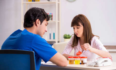 Patient visiting doctor for urine test