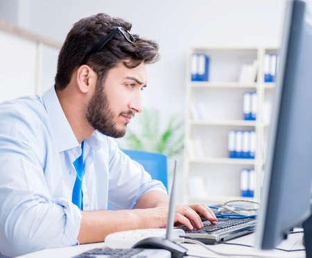 IT technician looking at IT equipment Stock fotó