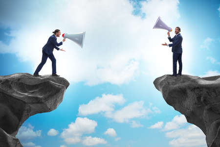 Businessman shouting with loudspeaker at each other
