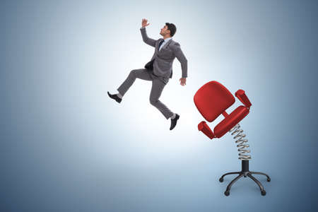 Promotion concept with businessman ejected from chair