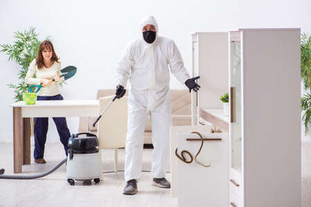 Young male contractor exterminating snakes in the flat Stock Photo