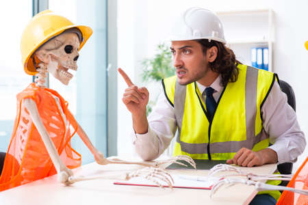 Funny construction business meeting with boss and skeletons