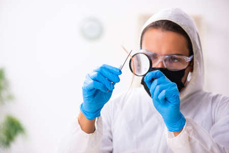 Male expert criminologist working in the lab for evidence Фото со стока