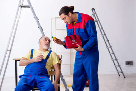 Two contractors in first aid concept