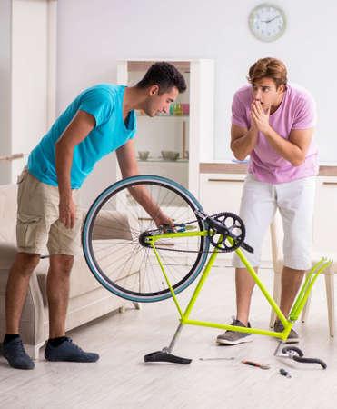 Man repairing his broken bicycle Stock Photo