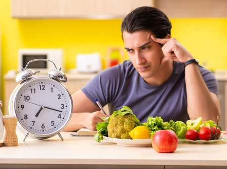 Young man in dieting and healthy eating concept Фото со стока