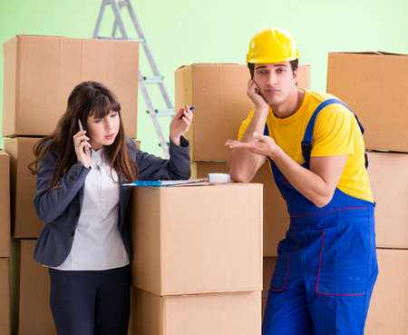 Woman boss and man contractor working with boxes delivery Stock Photo