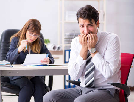 Man and woman discussing in office Stock fotó