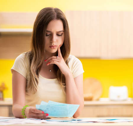Young woman wife in budget planning concept
