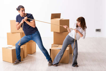 Young pair and many boxes in divorce settlement concept