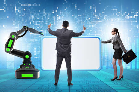Business people and blank poster supported by robotic arms Foto de archivo