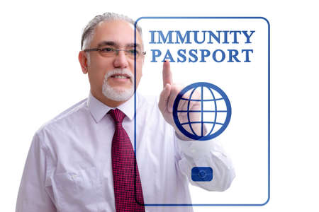 Concept of immunity passport - pressing virtual button Stockfoto