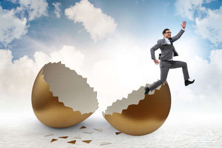Businessman breaking out of the golden egg