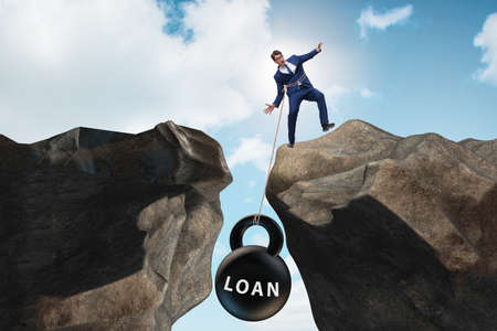 Concept of debt and load with businessman Reklamní fotografie