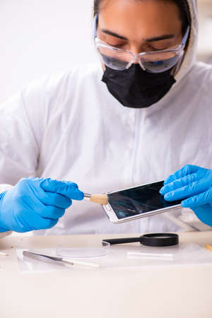 Male expert criminologist working in the lab for evidence Archivio Fotografico