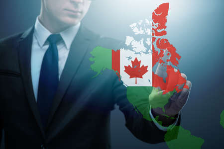 Concept of immigration to Canada with virtual button pressing
