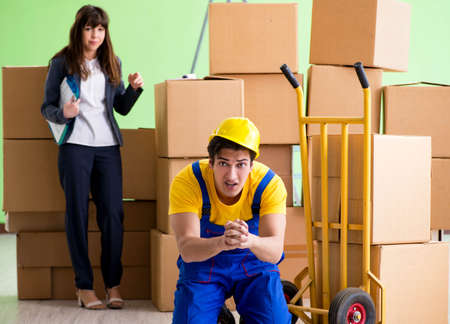 Woman boss and man contractor working with boxes delivery Foto de archivo