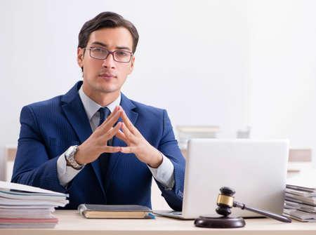 Young handsome judge working in court Zdjęcie Seryjne