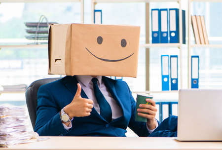 Happy man with box instead of his head