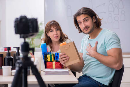 Young couple sales consultants recording video for their blog