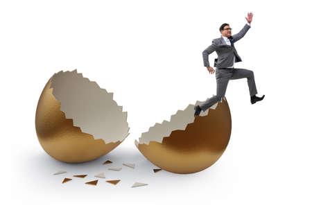 Businessman breaking out of golden egg