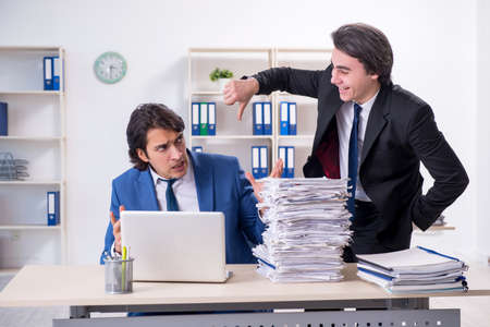 Two male colleagues unhappy with excessive work Reklamní fotografie