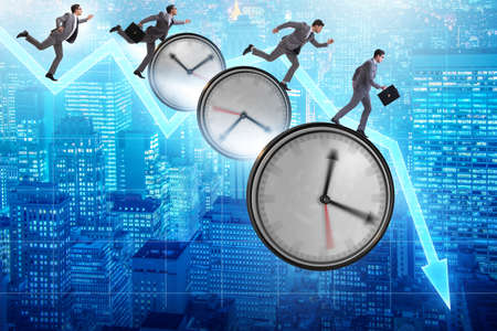 The concept of recession and decline with time clocks Stock Photo