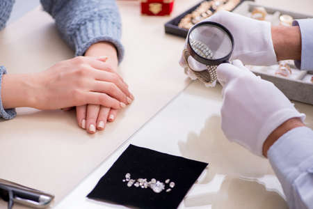Male jeweler and female client at store 版權商用圖片