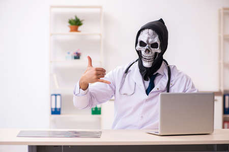 Male devil doctor working in the clinic