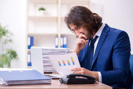 Young employee unhappy with excessive work