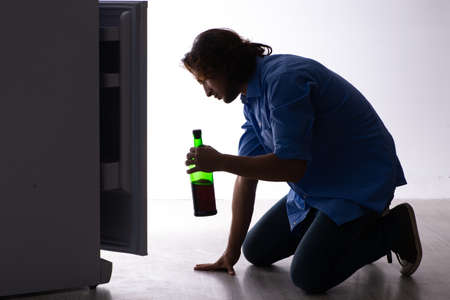 Young man suffering from the alcoholism