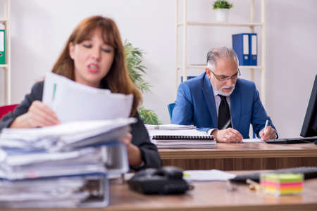 Two employees working in the office Imagens