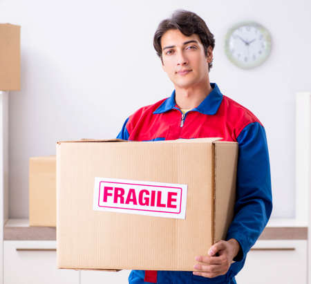 Transportation contractor with fragile boxes Stock Photo