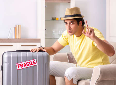 Man going on vacation with fragile suitcases