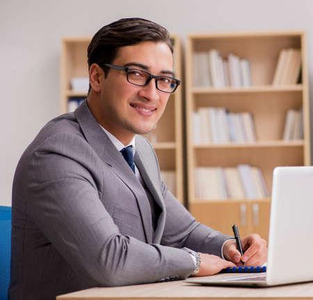 Young handsome businessman working on office Zdjęcie Seryjne