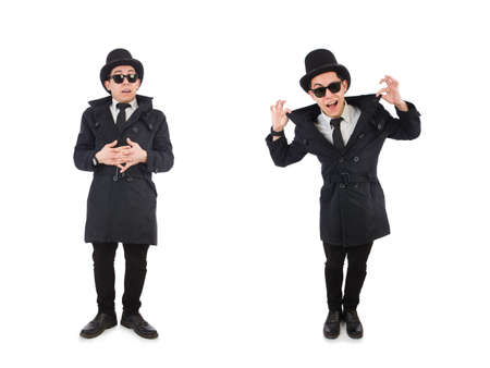 Young detective in black coat isolated on white Stock Photo