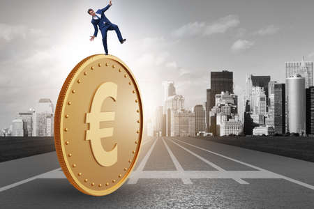 Businessman with the giant golden euro coin