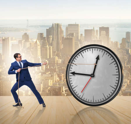 Businessman in time management concept Stockfoto