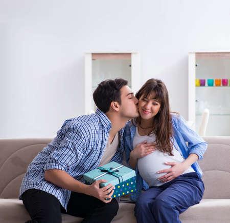 Happy family celebrating pregnancy at home