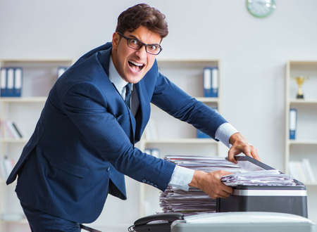 Businessman making copies in copying machine