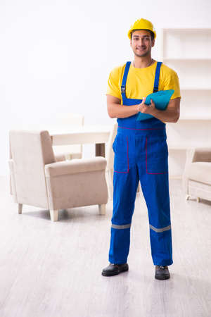 Young male contractor in relocation concept Stock Photo