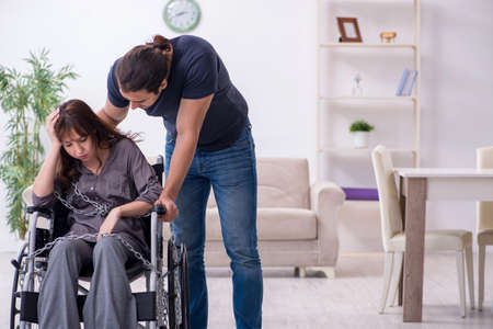 Disabled wife and young husband at home