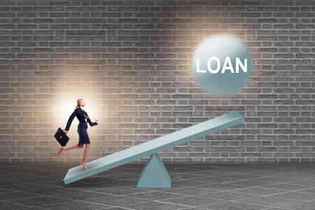 Debt and loan concept with businesswoman and seesaw