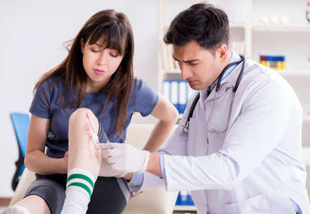 Patient visiting doctor after sustaining sports injury