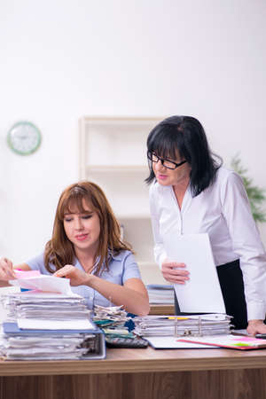Two female employees and excessive work in the office