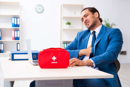 Young male employee in first aid concept Stok Fotoğraf