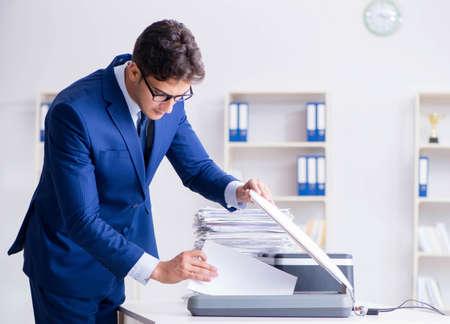 The businessman making copies in copying machine 版權商用圖片