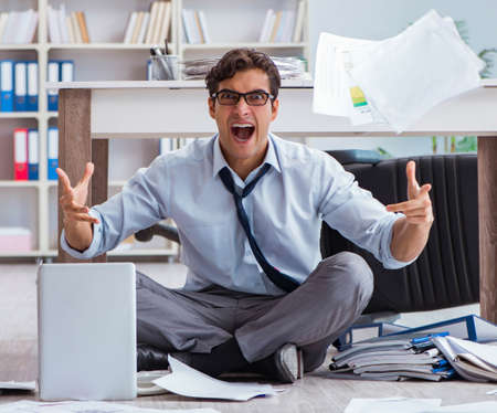 Bankrupt businessman angry in the office floor Stock Photo