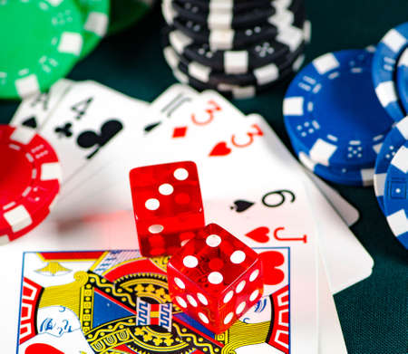 Chips and cards on casino table Stock Photo